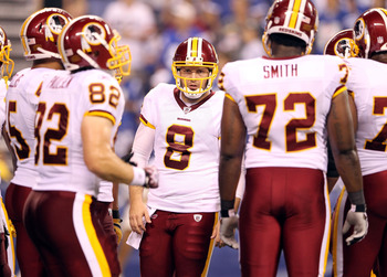 INDIANAPOLIS, IN - AUGUST 19:  Rex Grossman #8 of the Washington Redskins calls a play in the huddle during the game against Indianapolis Colts at Lucas Oil Stadium on August 19, 2011 in Indianapolis, Indiana.  (Photo by Andy Lyons/Getty Images)