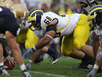 SOUTH BEND, IN - SEPTEMBER 11: Mike Martin #68 of the Michigan Wolverines awaits the start of play against the Notre Dame Fighting Irish at Notre Dame Stadium on September 11, 2010 in South Bend, Indiana. Michigan defeated Notre Dame 28-24.  (Photo by Jon