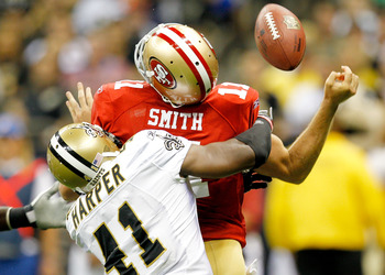 NEW ORLEANS, LA - AUGUST 12:  Alex Smith #11 of the San Francisco 49ers is hit by Roman Harper #41 of the New Orleans Saints during a preseason game at Louisiana Superdome on August 12, 2011 in New Orleans, Louisiana.  (Photo by Sean Gardner/Getty Images)