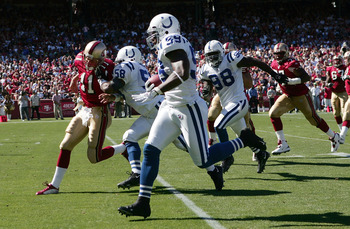 SAN FRANCISCO - OCTOBER 9:  Cato June #59 of the Indianapolis Colts returns an interception for a touchdown against Alex Smith #11 of the San Francisco 49ers NFL game at Monster Park on October 9, 2005 in San Francisco, California.  (Photo by Jed Jacobsoh