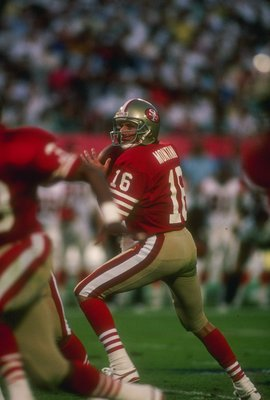 22 Jan 1989:  Quarterback Joe Montana of the San Francisco 49ers looks to pass the ball during Super Bowl XXIII against the Cincinnati Bengals at Joe Robbie Stadium in Miami, Florida.  The 49ers won the game, 20-16. Mandatory Credit: Rick Stewart  /Allspo