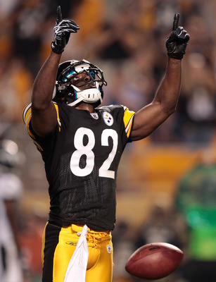 PITTSBURGH - AUGUST 18: Jerricho Cotchery #82 of the Pittsburgh Steelers celebrates after scoring a touchdown against the Philadelphia Eagles in the first half during the preseason game on August 18, 2011 at Heinz Field in Pittsburgh, Pennsylvania.  (Phot