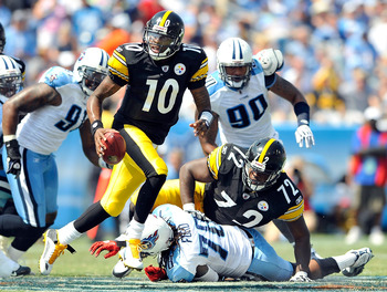 NASHVILLE, TN - SEPTEMBER 19:  Quarterback Dennis Dixon #10 of the Pittsburgh Steelers rolls out under pressure from the Tennessee Titans defense during the first half at LP Field on September 19, 2010 in Nashville, Tennessee.  (Photo by Grant Halverson/G