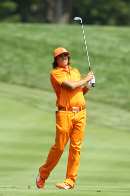 AKRON, OH - AUGUST 07:  Rickie Fowler hits an approach shot on the sixth hole during the final round of the World Golf Championships-Bridgestone Invitational on the South Course at Firestone Country Club on August 7, 2011 in Akron, Ohio.  (Photo by Andy L