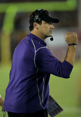 LOS ANGELES, CA - OCTOBER 02:  Head coach Steve Sarkisian of the Washington Huskies pumps his fist after a Huskies field goal in the third quarter against the USC Trojans at the  Angeles Memorial Coliseum on October 2, 2010 in Los Angeles, California.  Wa