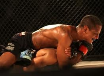 Johnny Eduardo clamping down on the rear-naked choke