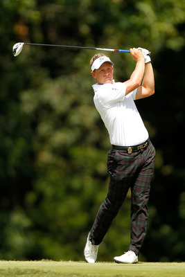 JOHNS CREEK, GA - AUGUST 14:  Luke Donald of England hits his tee shot on the ninth hole during the final round of the 93rd PGA Championship at the Atlanta Athletic Club on August 14, 2011 in Johns Creek, Georgia.  (Photo by Mike Ehrmann/Getty Images)