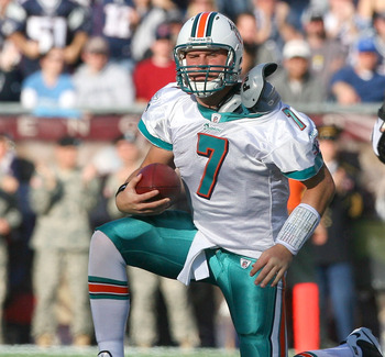 FOXBORO, MA - NOVEMBER 8:  Chad Henne #7 of the Miami Dolphons reacts after getting sacked against the New England Patriots at Gillette Stadium on November 8, 2009 in Foxboro, Massachusetts. (Photo by Jim Rogash/Getty Images)