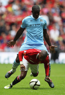 LONDON, ENGLAND - AUGUST 07:  Micah Richards of Manchester City tangles with Ashley Young of Manchester United during the FA Community Shield match sponsored by McDonald's between Manchester City and Manchester United at Wembley Stadium on August 7, 2011