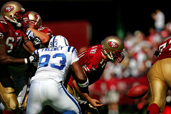 Indianapolis Colts defensive end Dwight Freeney (93) tackles San Francisco 49ers quarterback Alex Smith (11) causing a fumble at Monster Park in San Francisco, California on October 9, 2005. Indianapolis defeated San Francisco 28-3. (Photo by Allen Kee/NF