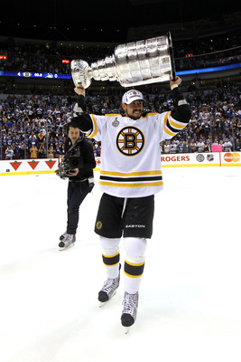 VANCOUVER, BC - JUNE 15:  Chris Kelly #23 of the Boston Bruins celebrates with the Stanley Cup after defeating the Vancouver Canucks in Game Seven of the 2011 NHL Stanley Cup Final at Rogers Arena on June 15, 2011 in Vancouver, British Columbia, Canada. T