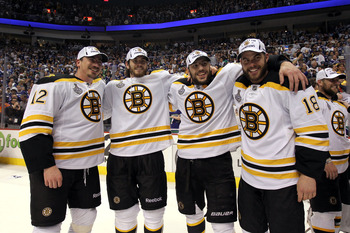 VANCOUVER, BC - JUNE 15:  (L-R) Tomas Kaberle #12, Adam McQuaid #54, Milan Lucic #17 and Nathan Horton #18 of the Boston Bruins celebrates winning the Stanley Cup after defeating the Vancouver Canucks in Game Seven of the 2011 NHL Stanley Cup Final at Rog