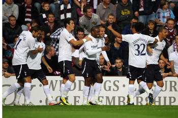 EDINBURGH, SCOTLAND - AUGUST 18:  Rafael van der Vaart of Tottenham is congratulated by team mates after he scores the first goal of the game during the UEFA Europa League Playoff first leg match between Heart of Midlothian FC and Tottenham Hotspur FC at