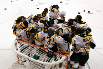 VANCOUVER, BC - JUNE 15:  Adam McQuaid #54 of the Boston Bruins celebrates with his teammates Brad Marchand #63, Tyler Seguin #19, Tim Thomas #30 and Zdeno Chara #33 after defeating the Vancouver Canucks in Game Seven of the 2011 NHL Stanley Cup Final at