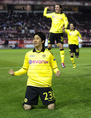 SEVILLE, SPAIN - DECEMBER 15:  Shinji Kagawa of Borussia Dortmund celebrates after scoring the opening goal during the UEFA Europa League group J match between Sevilla and Borussia Dortmund at Estadio Ramon Sanchez Pizjuan on December 15, 2010 in Seville,