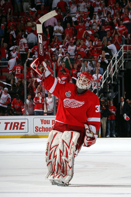 DETROIT - JUNE 06:  Goaltender Chris Osgood #30 of the Detroit Red Wings celebrates after defeating the Pittsburgh Penguins by a score of 5-0 to win Game Five of the 2009 NHL Stanley Cup Finals at Joe Louis Arena on June 6, 2009 in Detroit, Michigan.  (Ph