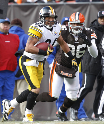 CLEVELAND, OH - JANUARY 02:  Wide receiver Hines Ward #86 of the Pittsburgh Steelers runs the ball by linebacker David Bowens #96 of the Cleveland Browns at Cleveland Browns Stadium on January 2, 2011 in Cleveland, Ohio.  (Photo by Matt Sullivan/Getty Ima