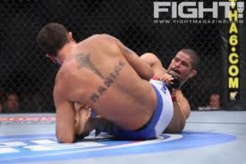 Rousimar Palhares working for a leg lock