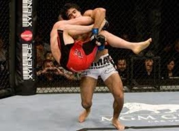 Thiago Tavares securing a double-leg take-down