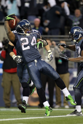 SEATTLE, WA - JANUARY 08:  Running back Marshawn Lynch #24 of the Seattle Seahawks jumps across the goalline as he runs for a 67-yard touchdown run in the fourth quarter against the New Orleans Saints during the 2011 NFC wild-card playoff game at Qwest Fi