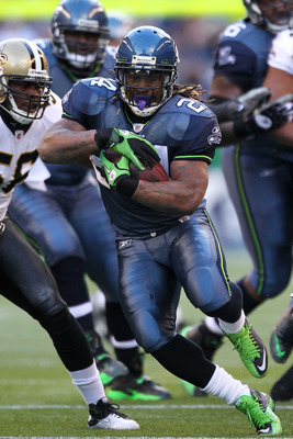SEATTLE, WA - JANUARY 08:  Marshawn Lynch #24 of the Seattle Seahawks runs down field against the New Orleans Saints during the 2011 NFC wild-card playoff game at Qwest Field on January 8, 2011 in Seattle, Washington.  (Photo by Otto Greule Jr/Getty Image