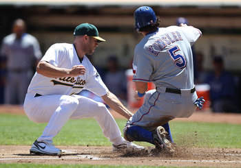OAKLAND, CA - AUGUST 14:  Rich Harden #18 of the Oakland Athletics fails to tag out Ian Kinsler #5 of the Texas Rangers on a wild pitch in the first inning at O.co Coliseum on August 14, 2011 in Oakland, California.  (Photo by Jed Jacobsohn/Getty Images)