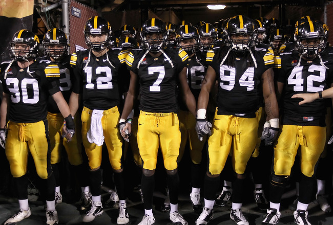 TEMPE, AZ - DECEMBER 28:  (L-R) De'Andre Johnson #30, Ricky Stanzi #12, Marvin McNutt #7, Adrian Clayborn #94 and Jeremiha Hunter #42 of the Iowa Hawkeyes prepare to take the field for the Insight Bowl against the Missouri Tigers at Sun Devil Stadium on D