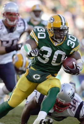 GREEN BAY, WI - NOVEMBER 19: Ahman Green #30 of the Green Bay Packers carries the ball during the game against the New England Patriots on November 19, 2006 at Lambeau Field in Green Bay, Wisconsin. The Patriots defeated the Packers 35-0. (Photo by Jonath
