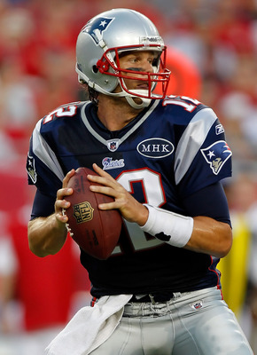 TAMPA, FL - AUGUST 18:  Quarterback Tom Brady #12 of the New England Patriots looks for the open receiver against the Tampa Bay Buccaneers during a preseason game at Raymond James Stadium on August 18, 2011 in Tampa, Florida.  (Photo by J. Meric/Getty Ima