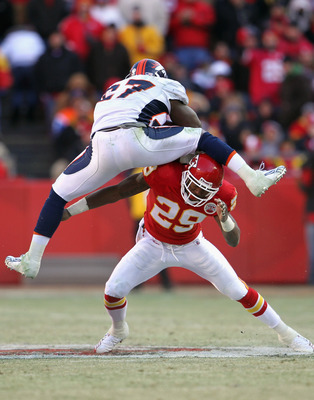 KANSAS CITY, MO - DECEMBER 05:  Knowshon Moreno #27 of the Denver Broncos tries to leap over Eric Berry #29 of the Kansas City Chiefs as he carries the ball during the game on December 5, 2010 at Arrowhead Stadium in Kansas City, Missouri.  (Photo by Jami