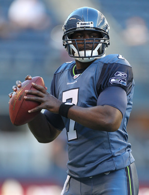 SEATTLE - AUGUST 20:  Quarterback Tarvaris Jackson #7 of the Seattle Seahawks warms up prior to the game against the Minnesota Vikings at CenturyLink Field on August 20, 2011 in Seattle, Washington. The Vikings won 20-7. (Photo by Otto Greule Jr/Getty Ima