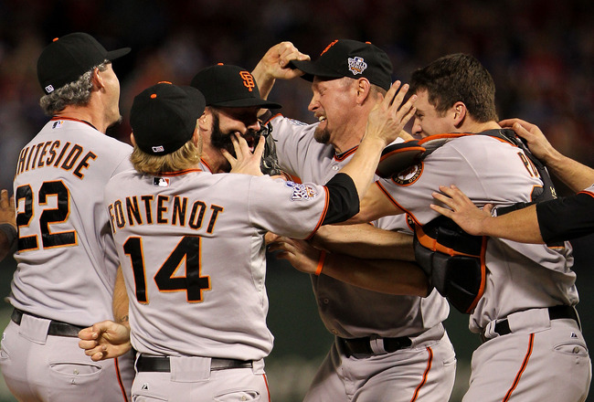 ARLINGTON, TX - NOVEMBER 01:  Brian Wilson #38 and catcher Buster Posey #28 of the San Francisco Giants celebrate with their teammates after the Giants won 3-1 against the Texas Rangers in Game Five of the 2010 MLB World Series at Rangers Ballpark in Arli