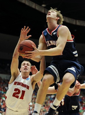 TUCSON, AZ - MARCH 17:  Mick Hedgepeth #34 of the Belmont Bruins goes up against Josh Gasser #21 of the Wisconsin Badgers during the second round of the 2011 NCAA men's basketball tournament at McKale Center on March 17, 2011 in Tucson, Arizona.  (Photo b