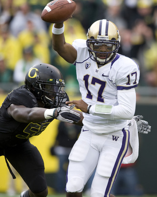 EUGENE, OR - NOVEMBER 6: Quarterback Keith Price #17 of the Washington Huskies is pressured by linebacker Josh Kaddu #56 of the Oregon Ducks in the third quarter of the game at Autzen Stadium on November 6, 2010 in Eugene, Oregon. The Ducks won the game 5