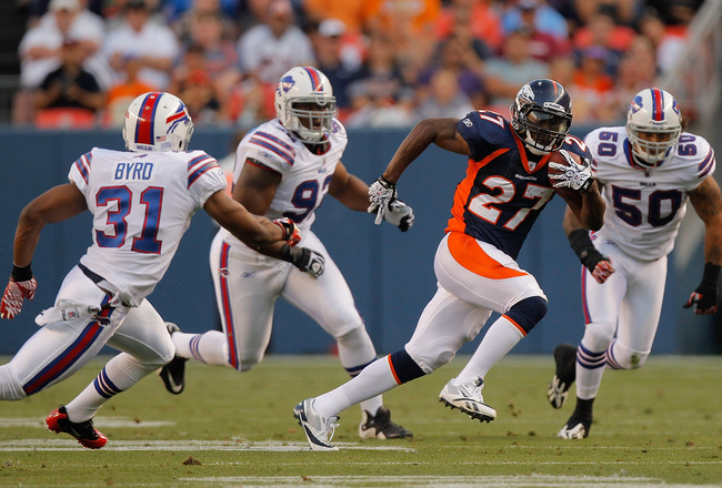 DENVER, CO - AUGUST 20:  Running back Knowshon Moreno #27 of the Denver Broncos splits the defense of safety Jairus Byrd #31, Alex Carrington #92 and linebacker Nick Barnett #50 of the Buffalo Bills during the first quarter at Sports Authority Field at Mi