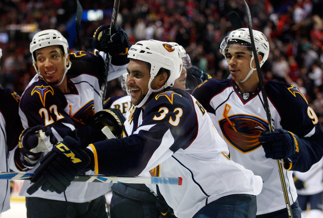 MONTREAL, CANADA - JANUARY 2:  Dustin Byfuglien #33 of the Atlanta Thrashers celebrates his overtime goal with team mates during the NHL game against the Montreal Canadiens at the Bell Centre on January 2, 2011 in Montreal, Quebec, Canada.  The Thrashers