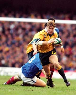 Horan breaks a tackle in the 1999 Final vs France.