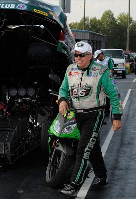 CONCORD, NC - SEPTEMBER 17:  John Force, driver of the Castrol High Miledge Ford Funny Car prepares to drive at zMax Dragway on September 17, 2010 in Concord, North Carolina.  (Photo by Rusty Jarrett/Getty Images)