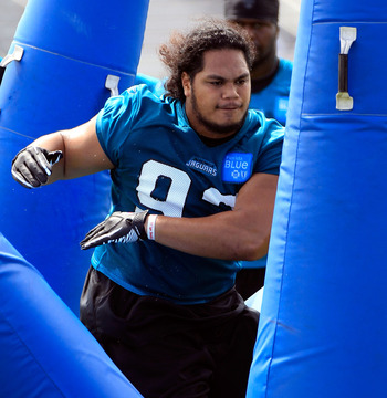 JACKSONVILLE, FL - JULY 28:  Tyson Alualu #93 of the Jacksonville Jaguars takes part in training camp at Florida Blue Health and Wellness practice fields on July 28, 2011 in Jacksonville, Florida.  (Photo by Sam Greenwood/Getty Images)