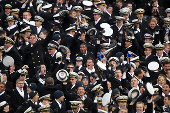 PHILADELPHIA - DECEMBER 11: The Navy Midshipmen celebrate a touchdown during a game against the Army Black Knights on December 11, 2010 at Lincoln Financial Field in Philadelphia, Pennsylvania. The Midshipmen won 31-17. (Photo by Hunter Martin/Getty Image