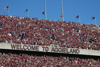 COLLEGE STATION, TX - NOVEMBER 6:  Texas A&amp;M University Aggies fans, sometimes referred to as the 12th Man, watch the game against the University of Oklahoma Sooners on November 6, 2004 at Kyle Field in College Station, Texas. The Sooners defeated the Agg