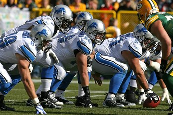 GREEN BAY, WI - OCTOBER 18: Members of the Detroit Lion offensive line including Stephen Peterman #66 and Dominic Raiola #51 prepare for the start of play against the Green Bay Packers at Lambeau Field on October 18, 2009 in Green Bay, Wisconsin. The Pack