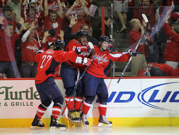 WASHINGTON - APRIL 17: Nicklas Backstrom #19 (R) of the Washington Capitals scores in overtime and is joined by Mike Knuble #22 (L) and Alex Ovechkin #8 (C) to defeat the Montreal Canadiens 6-5  in Game Two of the Eastern Conference Quarterfinals during t