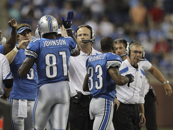 DETROIT - AUGUST 12: Calvin Johnson #81 of the Detroit Lions celebrates a first quarter touchdown during the game against the Cincinnati Bengals at Ford Field on August 12, 2011 in Detroit, Michigan.  (Photo by Leon Halip/Getty Images)