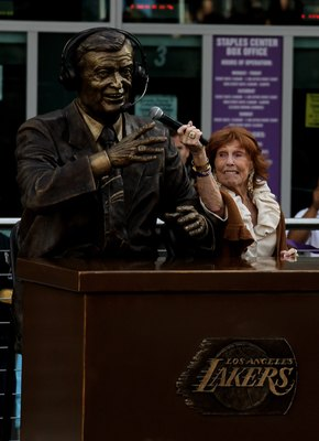 LOS ANGELES, CA - APRIL 20:  Marge Hearn, widow of legendary Los Angeles Lakers broadcaster Chick Hearn, holds up a microphone to a statue of Chick at unveiling ceremonies before the Los Angeles Lakers and the Oklahoma City Thunder's  Game Two of the West