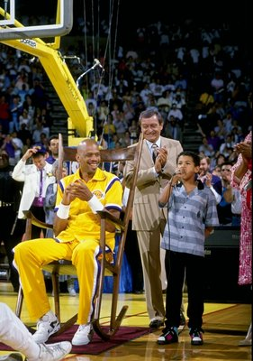 INGLEWOOD, CA - 1990:  Announcer Chick Hearn (center) and Kareem Abdul-Jabbar #33 of the Los Angeles Lakers attend a ceremony for the retirement of Jabbar's jersey number at the Great Western Forum in Inglewood, California.  (Photo by Stephen Dunn/Getty I