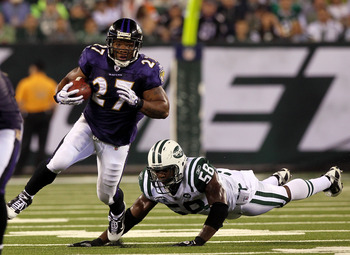 EAST RUTHERFORD, NJ - SEPTEMBER 13:  Ray Rice #27 of the Baltimore Ravens runs against Bryan Thomas #58 of the New York Jets during their home opener at the New Meadowlands Stadium on September 13, 2010 in East Rutherford, New Jersey.  (Photo by Jim McIsa