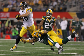 ARLINGTON, TX - FEBRUARY 06:  Hines Ward #86 of the Pittsburgh Steelers tries to avoid the tackle of Desmond Bishop #55 of the Green Bay Packers during Super Bowl XLV at Cowboys Stadium on February 6, 2011 in Arlington, Texas.  (Photo by Doug Pensinger/Ge