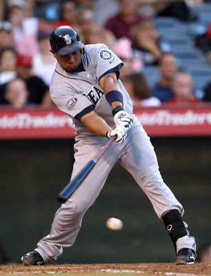 ANAHEIM, CA - AUGUST 6:  Miguel Olivo #30 of the Seattle Mariners hits an RBI single in the third inning against the Los Angeles Angels of Anaheim on August 6, 2011 at Angel Stadium in Anaheim, California.   (Photo by Stephen Dunn/Getty Images)
