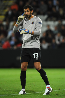 ODENSE, DENMARK - AUGUST 17:  Diego Lopez of Villarreal CF gestures during the UEFA Champions League play-off first leg match between Odense BK and Villarreal CF at TRE-FOR Park stadium on August 17, 2011 in Odense, Denmark.  (Photo by Valerio Pennicino/G